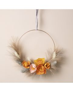 An autumn wreath with crepe paper flowers and pampas grass