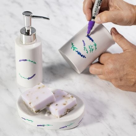 A soap dish and a soap dispenser decorated with porcelain markers