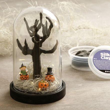 A Halloween miniature world in a dome bell jar