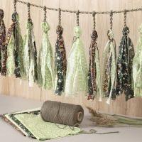 A macramé cord garland with fabric tassels