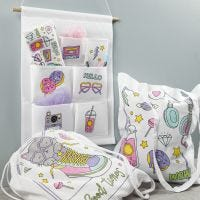 Pre-printed fabric items decorated with textile markers