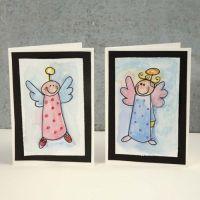 Een kerstkaart met een aquarel engel