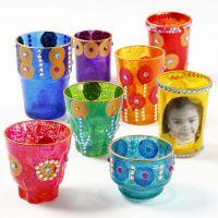 Decoraties op diverse glazen kaarshouders